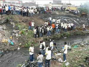 Thousands of Volunteers clean up a section of the Nairobi River Bank in Embakassa and ten other of Nairobi's poorest neighborhoods