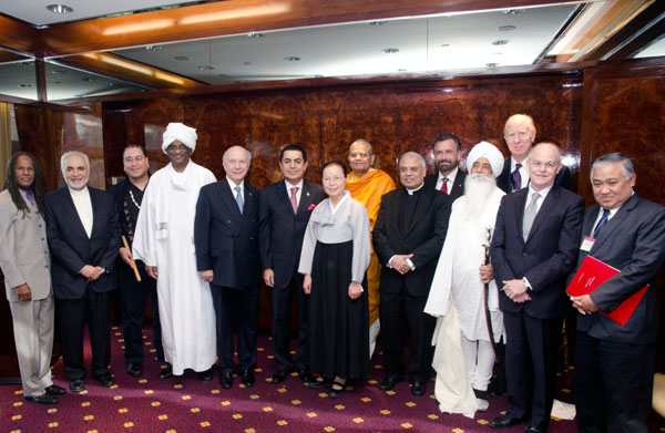 Some of the religious leaders and program speakers with General Assembly President Nassir Al-Nasser at a post-event luncheon