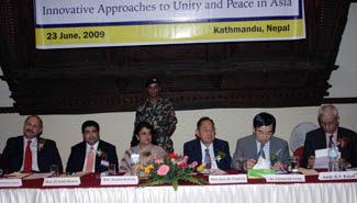 Left to right: Mushahid Hussain Sayed, former Minister of Information and Broadcasting as well as Minister of Tourism, Pakistan; Ek Nath Dhakal, member of Nepal's Constituent Assembly and chairman of UPF-Nepal; Sujata Koirala, Nepal's Minister of Foreign Affairs; Jose De Venecia, former Speaker of the House of Representatives of the Philippines and Chairman of the International Conference on Asian Political Parties; Chung Sik Yong, regional chair of UPF-Asia; and Ambassador K.V. Rajan, President of the Indian Diplomatic Forum and former ambassador of India to Nepal.